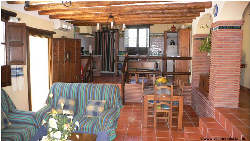 orgiva alpujarras holiday rental villa finca rio seco livingroom, dining corner and kitchen