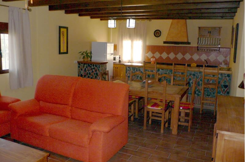 alpujarra orgiva holiday rental villa casa la piedra living room, dinner corner and kitchen