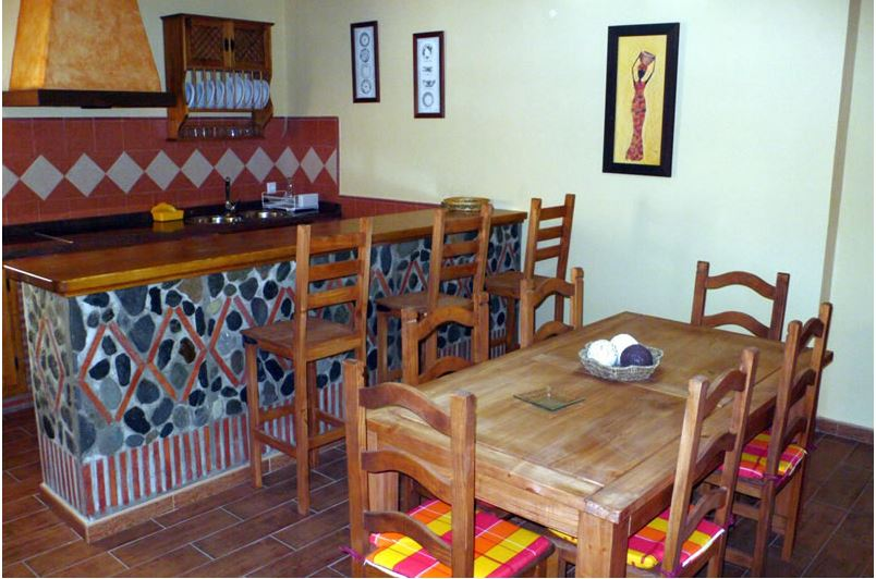 alpujarra orgiva holiday rental villa casa la piedra dinner corner and kitchen