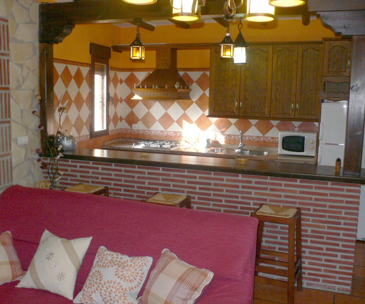 vacation rental cortijo limon órgiva alpujarras sofa and kitchen