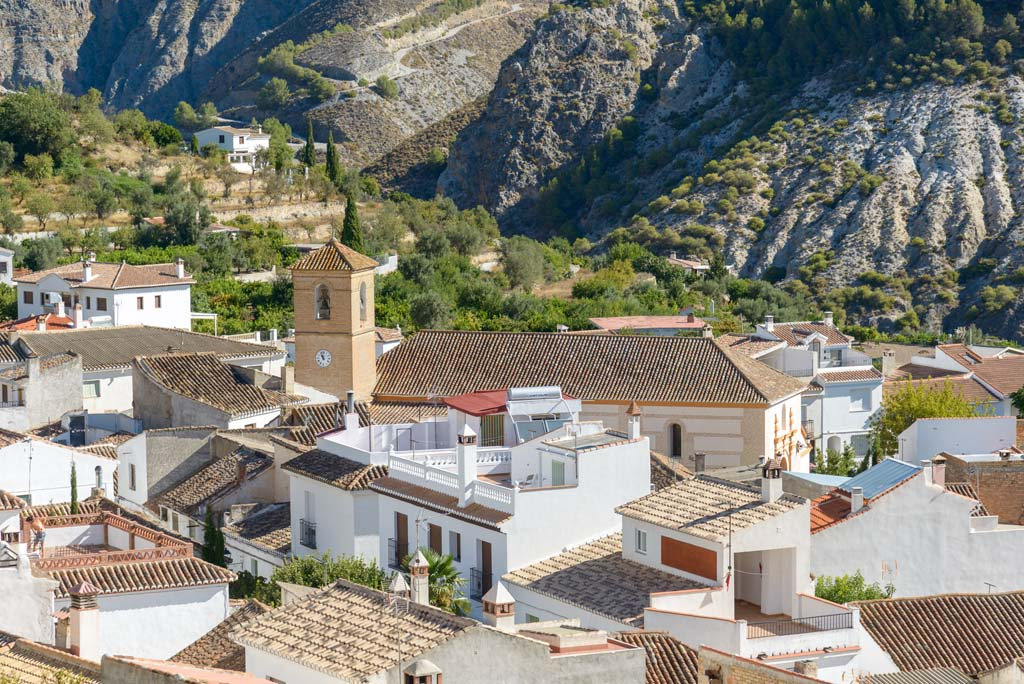 View of Conchar village in the Valley of Joy, Valle de Lécrin, Granada province church