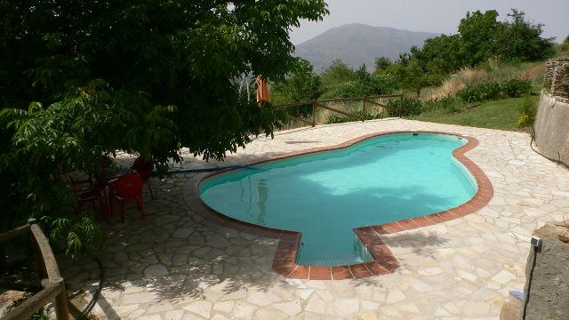 la alpujarra cortijo capilerilla bungalow piscine