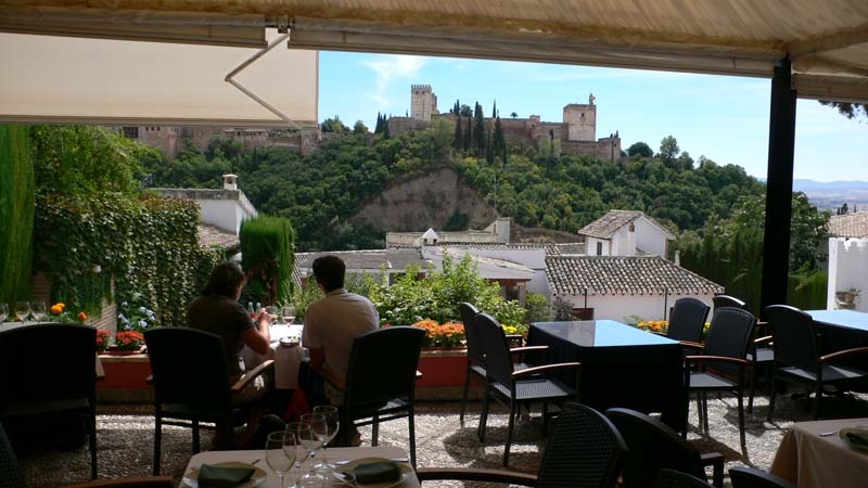 restaurant terrace with views onto the alhambra granada andalucia spain