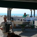 musician and frying sardines el palo beach malaga